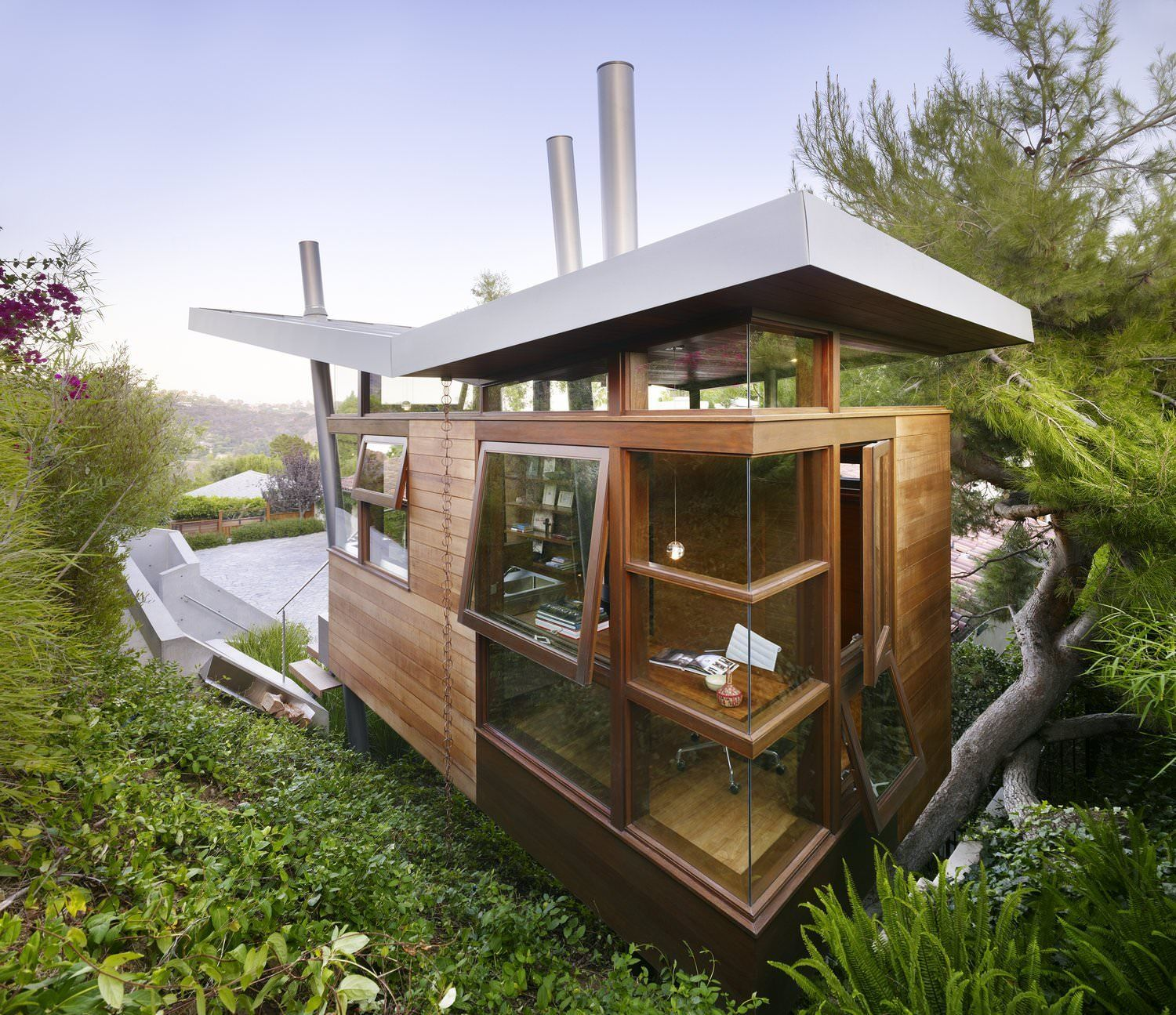 Compact Wooden Studioretreat Perched Atop Steel Pylons At The Base