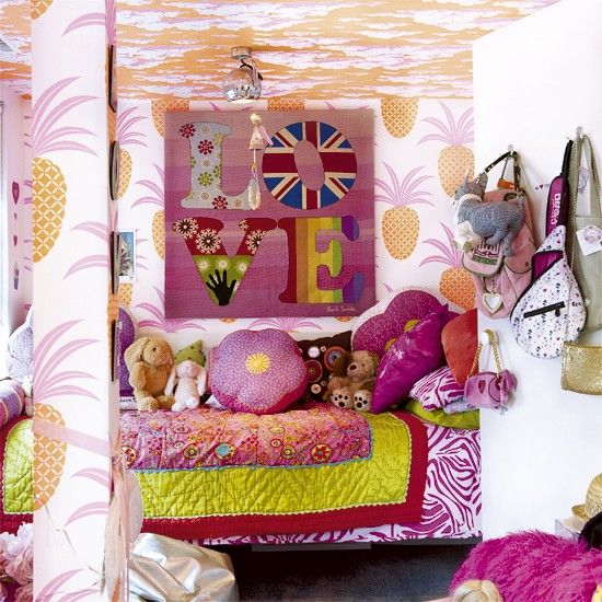 Pop art-inspired children's bedroom     The graphic orange and pink wallpaper on the walls and ceiling of this bedroom give it a colourful pop art-style feel. An abundance of cushions and throws in mismatched patterns create an eclectic look where clashing is encouraged.     Read more at http://www.housetohome.co.uk
