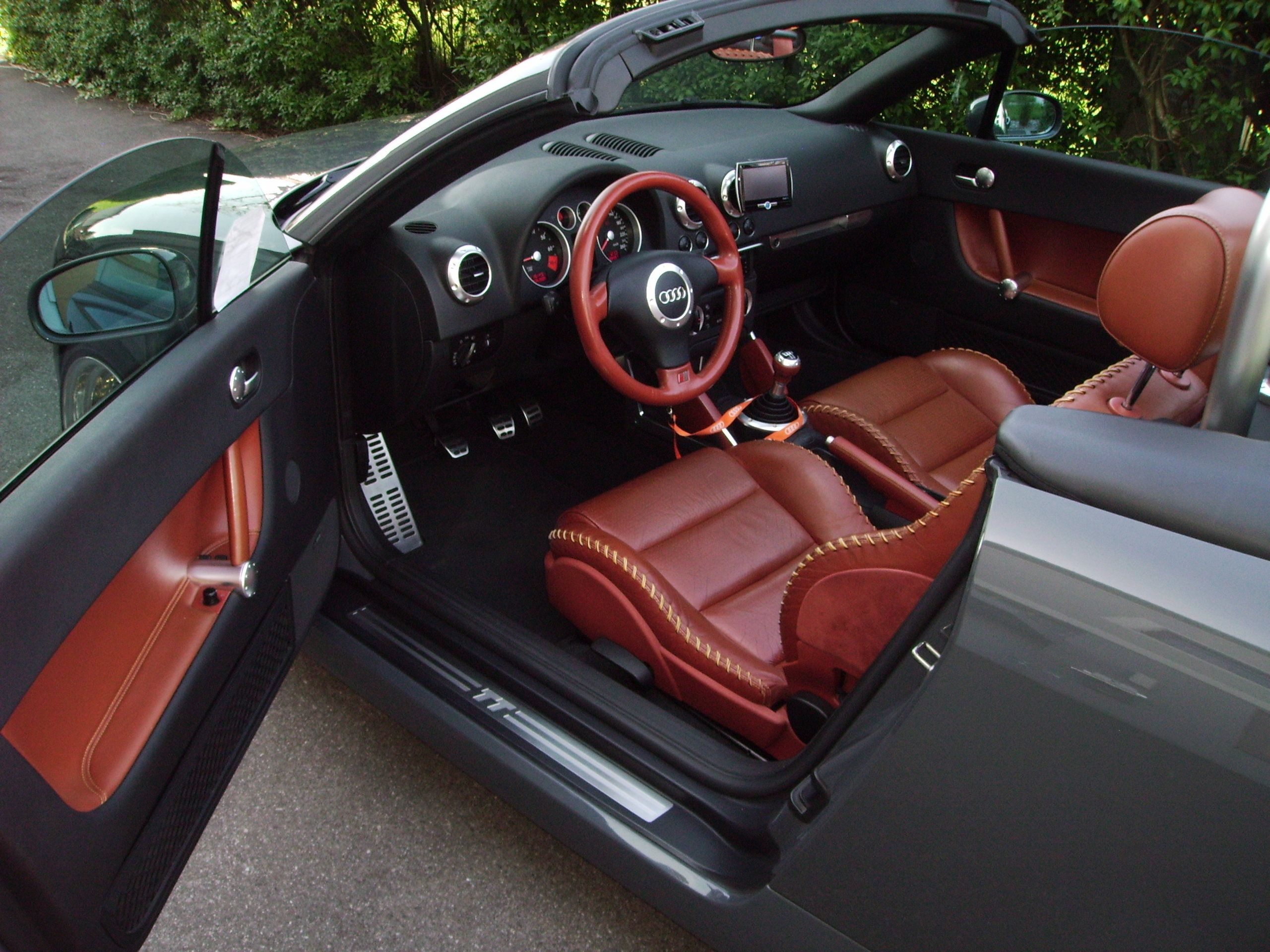 Audi tt roadster is available in the exclusive amber red leather interior with baseball stitching