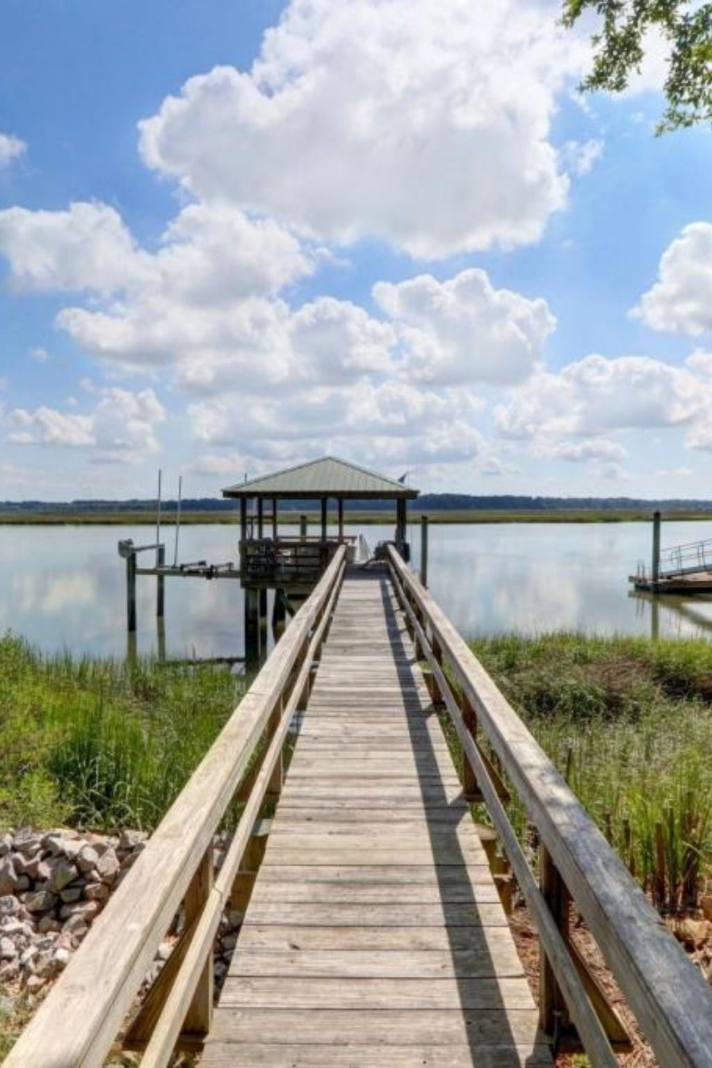 Classic custom Lowcountry home located on very deep water