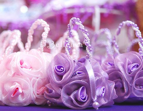Pink and lilac sachets can be filled with candy as baby shower favors with a vintage theme. #vintagebabyshowerfavors