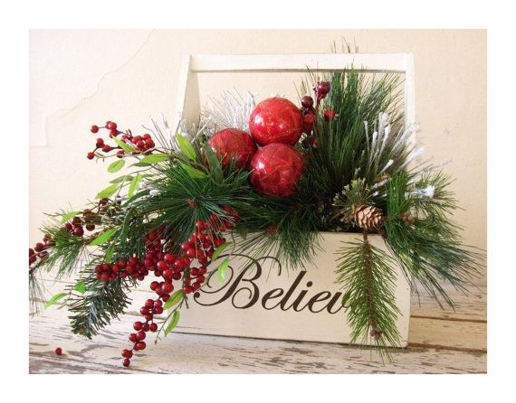 BELIEVE This holiday arrangement will be a great addition to your