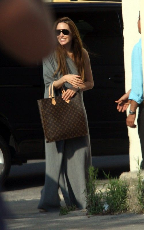 2f1e1eb922d6 Angelina Jolie was seen with her kids at a play park in the European  country of Malta carrying a Louis Vuitton Monogram Sac Plat Tote Bag ( .