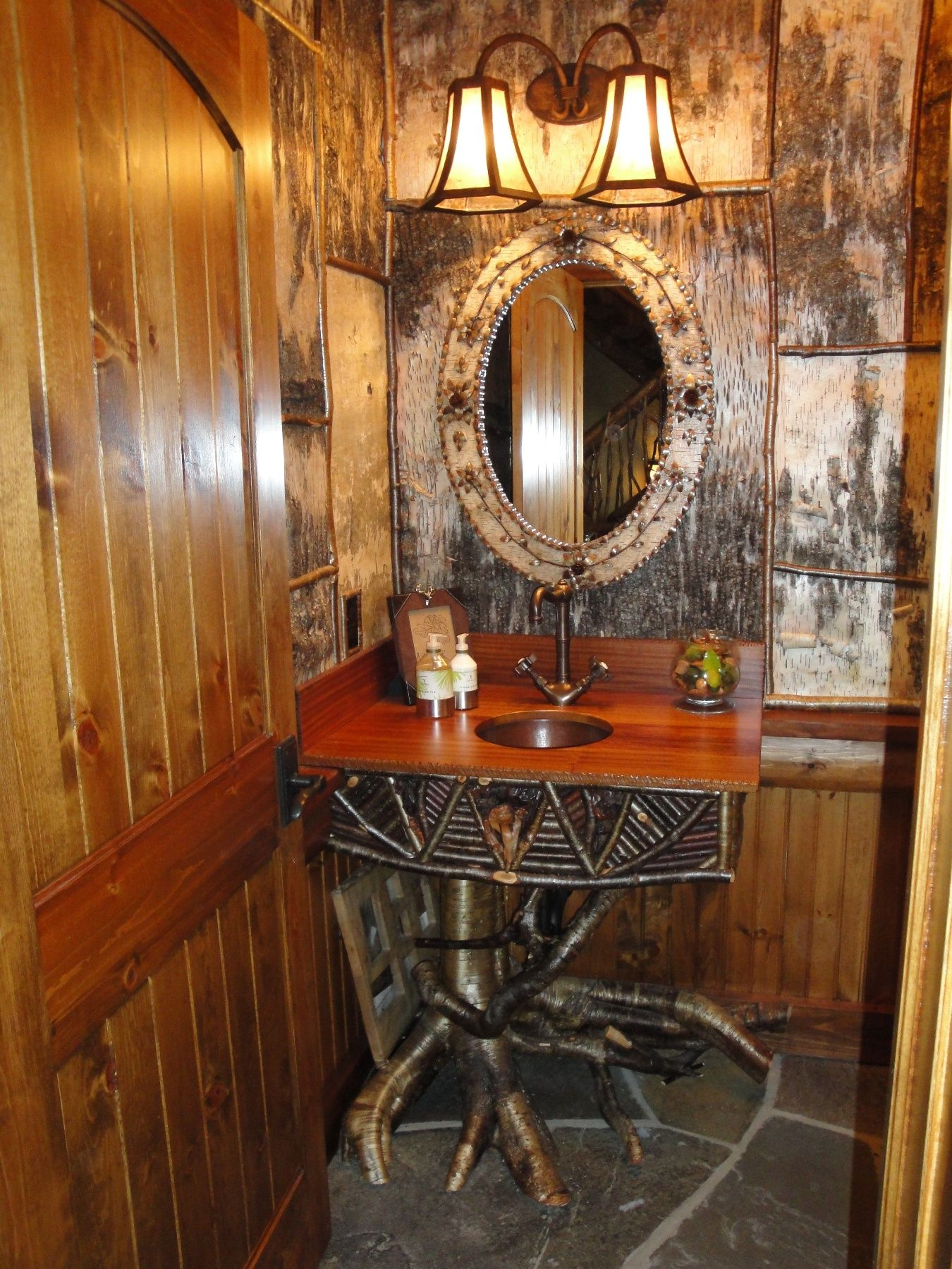This rustic Adirondack style powder room designed for one of my lake home  clients includes custom