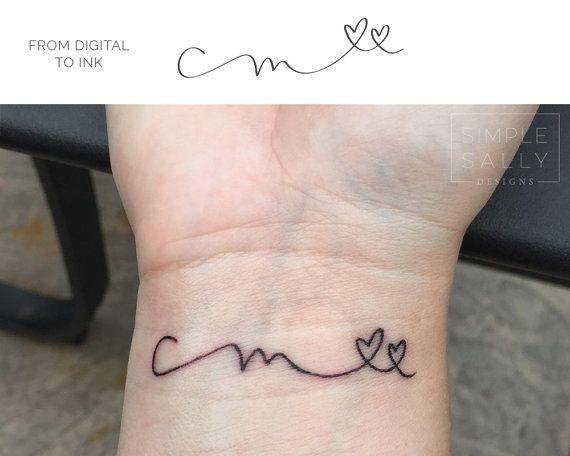 Buchstabe mit tattoo herz m Tattoo Ranken