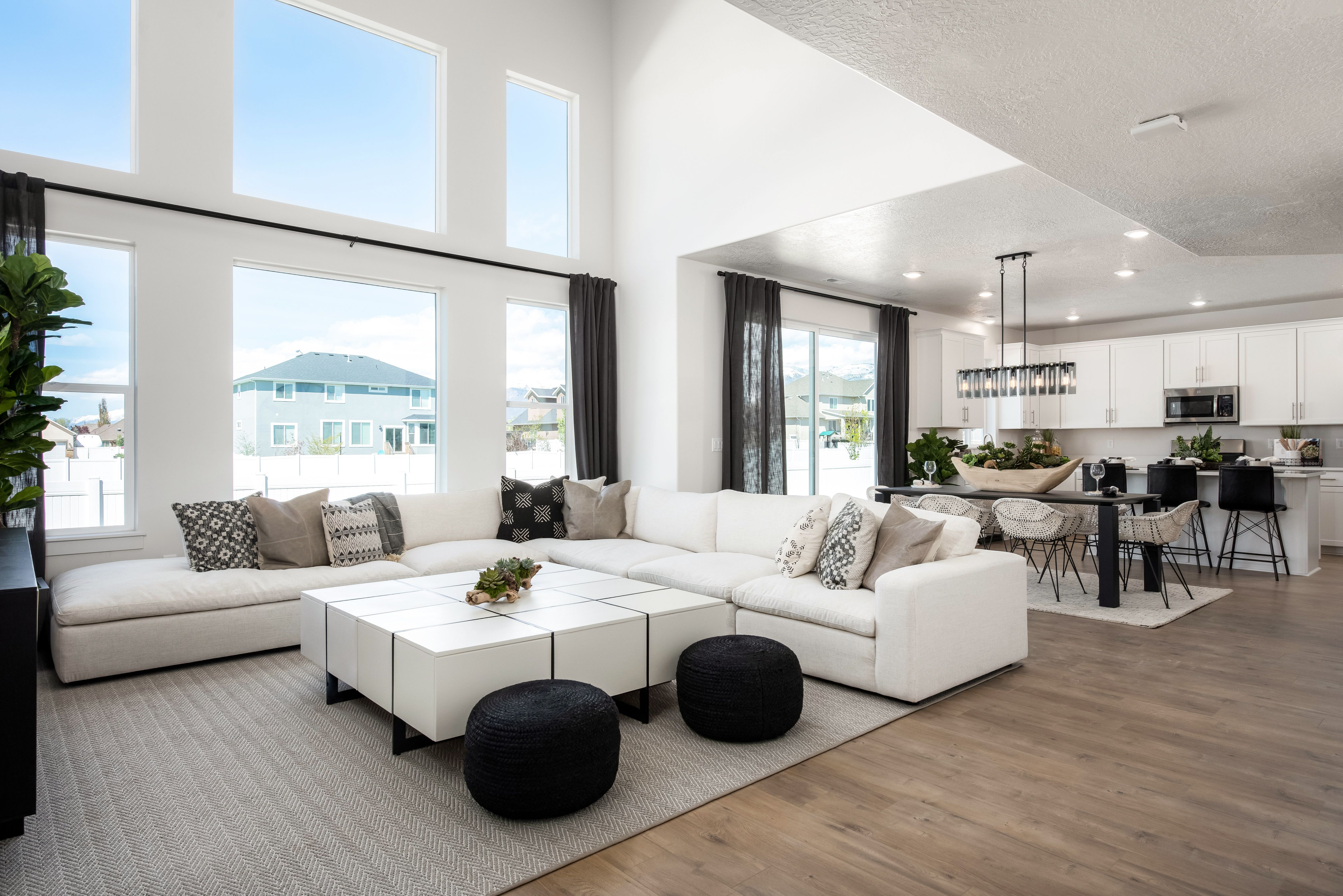 Black Accent Pieces Add Class In This Open Concept Layout At
