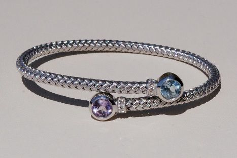 Sterling Silver Woven Cuff Bracelet with Diamonds, Amethyst, and Blue Topaz from J. Schrecker Jewelry. Visit us at our website or at www.facebook.com/JSchreckerJewelry