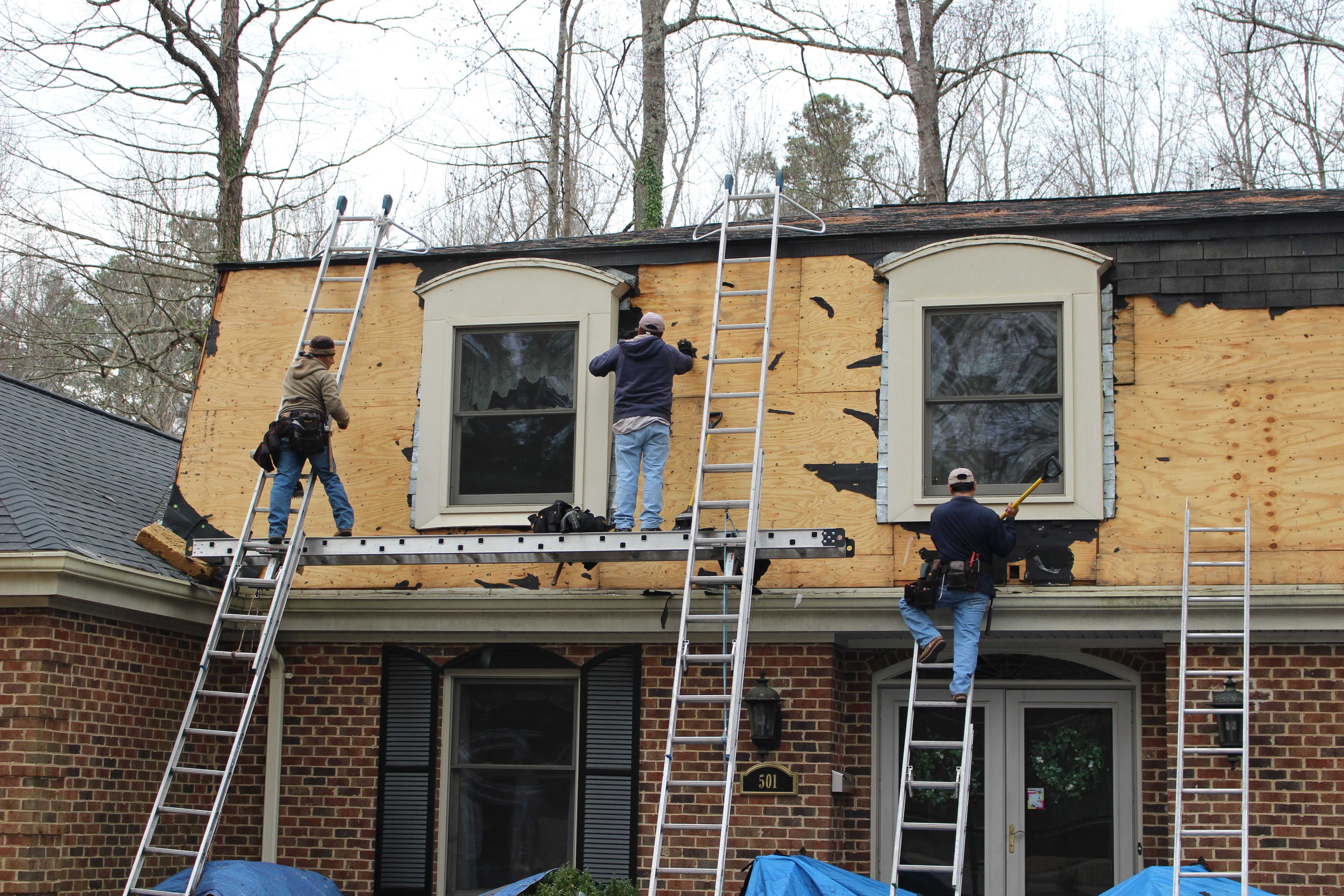 A Crs Crew Makes Sure The Deck Is Clean Of Roofing Nails To Begin Covering With An Underlayment Roofing Roofing Nails Architectural Shingles