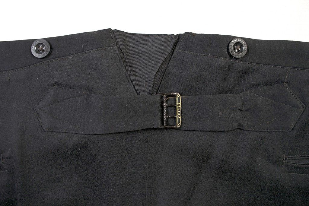 Both the back of the vest and the back of the trousers have adjustable tabs and buckles, which would have allowed Mr. Allison to let out his suit a little when needed.