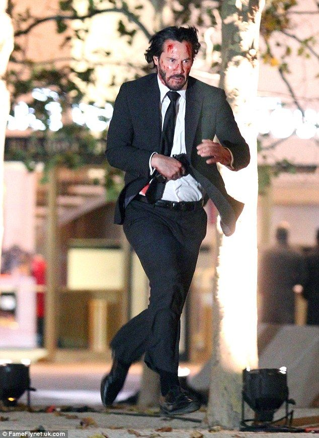 keanu reeves bloodied on set as he continues shooting film