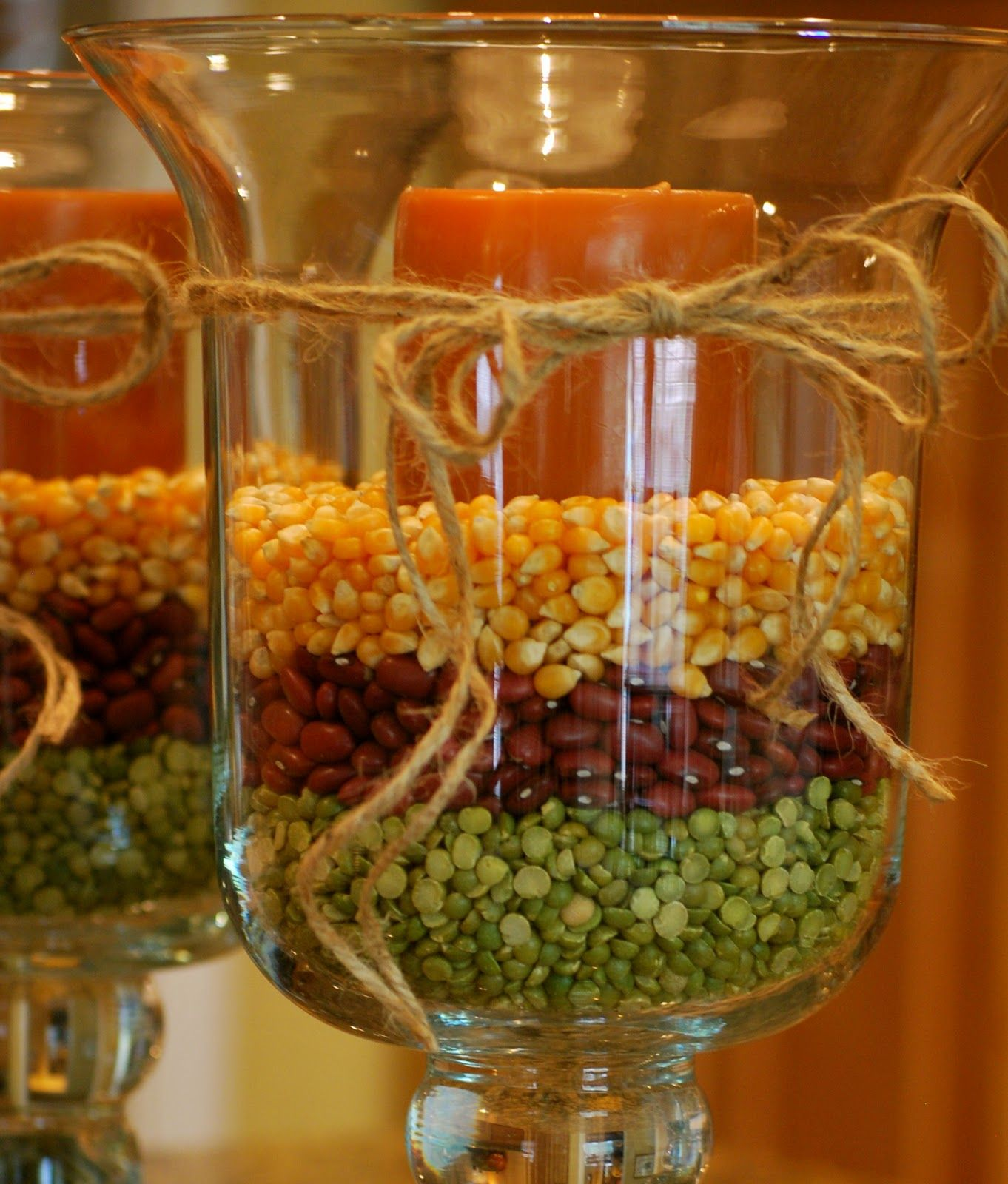 Hurricane glasses filled with dry split peas, red beans and corn kernels never looked so good! PERFECT fall decor!