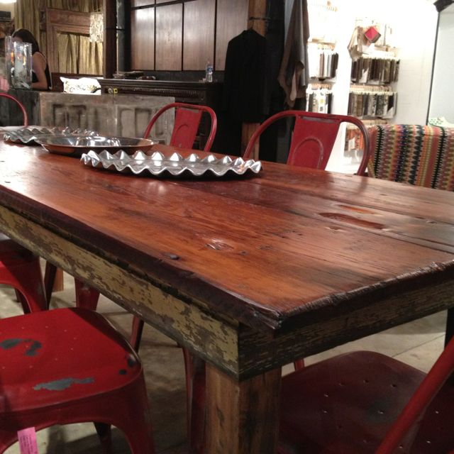 Upcycled dining room tables at 24e - wood is salvaged from historic Savannah homes.