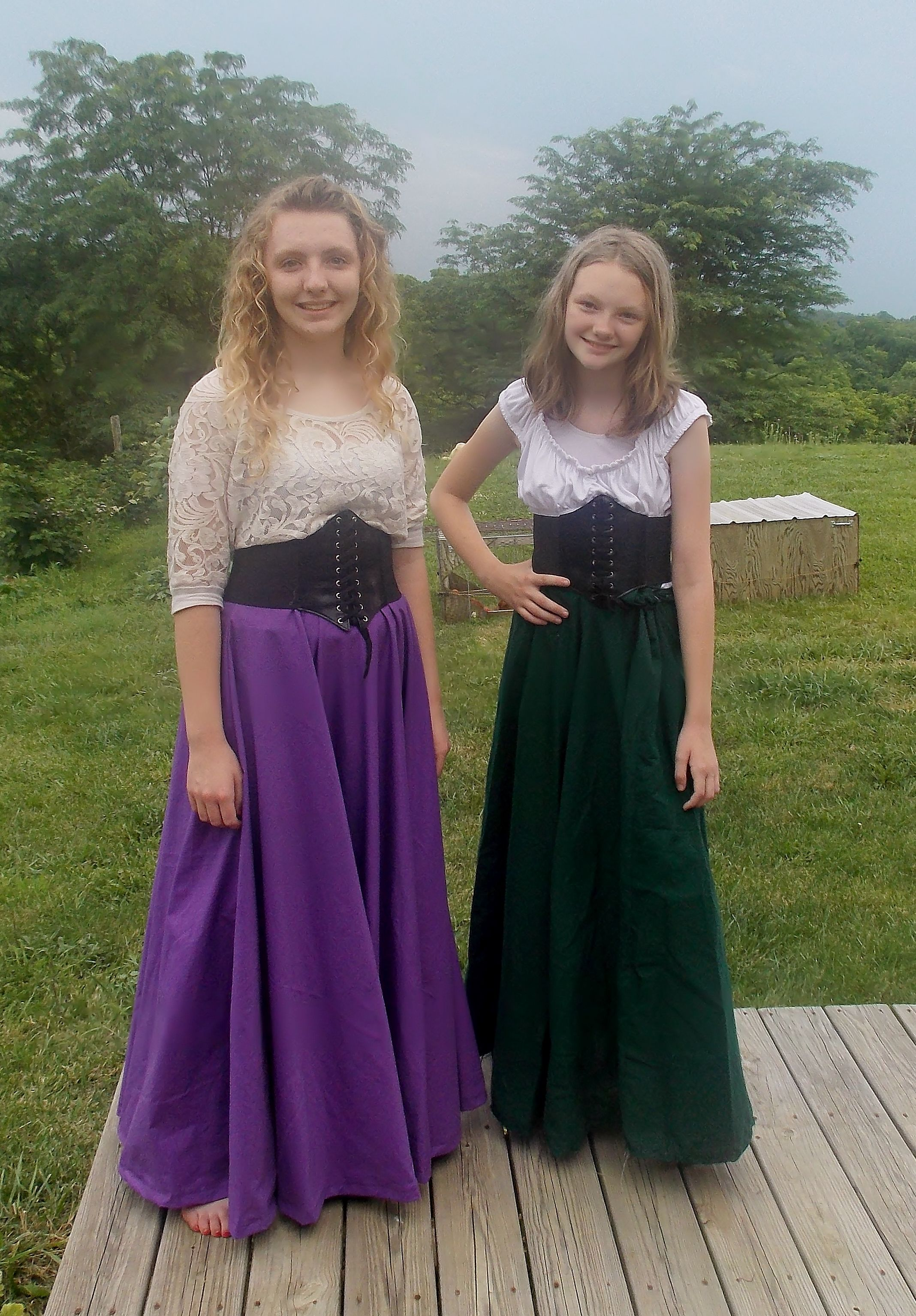 Homemade medieval outfits Circle skirts, peasant blouses and $2 corset  belts from Amazon.