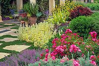 'Flower Carpet' rose and Stachys in perennial bed mixed border  with arbor in background. Design: Freeland Tanner