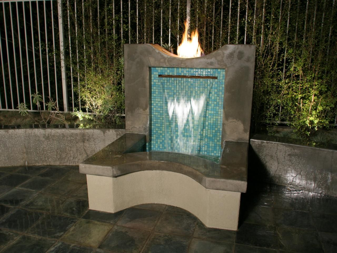 Diy water feature wall - The Mosaic Glass Tiles On The Back Wall Of The Water Feature Pop Against The
