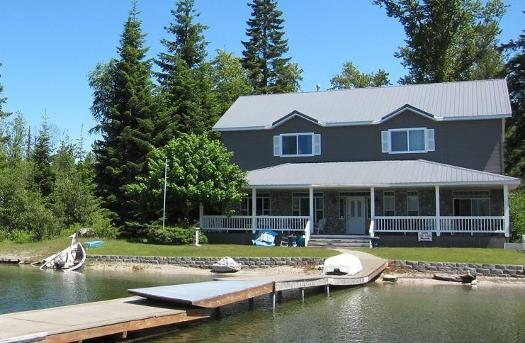 60' ff of deeded frontage on Priest Lake - the Crown Jewel of the State of Idaho. Convenient year round access. SW Exposure for ideal exposure to the sun and sunset views. Sandy beach. Flat level waterfront lot. 6 br 4 ba 2 story home. Unique and functional floor plan ideal for a large family or for 2 families with 3 br and 2 bath, living, dining and preparation areas on each level. Oversized 14' x 50' covered deck adds a very livable outdoor living room.