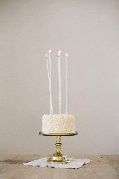 simple white birthday cake, use candles of different heights or sparkler candles (Walmart bakery)