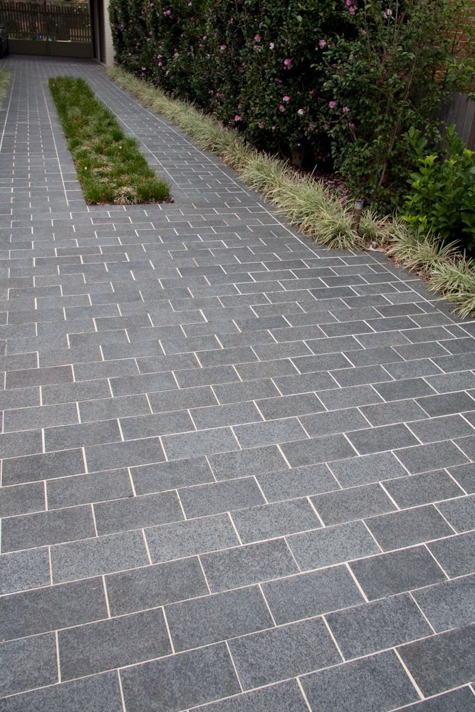 Jet Black Basalt Exfoliated Pavers used for a driveway ...