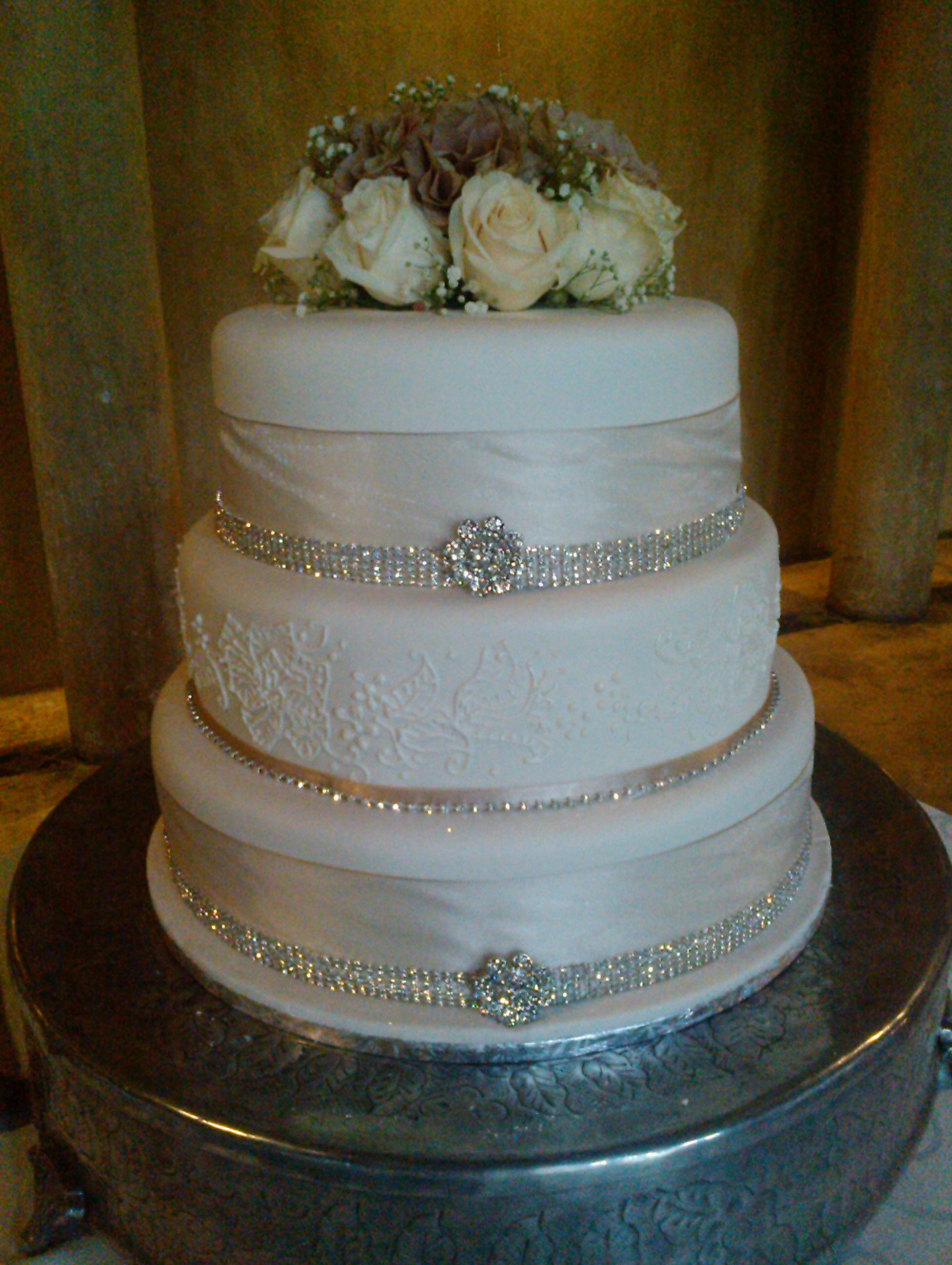 Diamante Wedding Cake With Champagne Ribbon And Roses