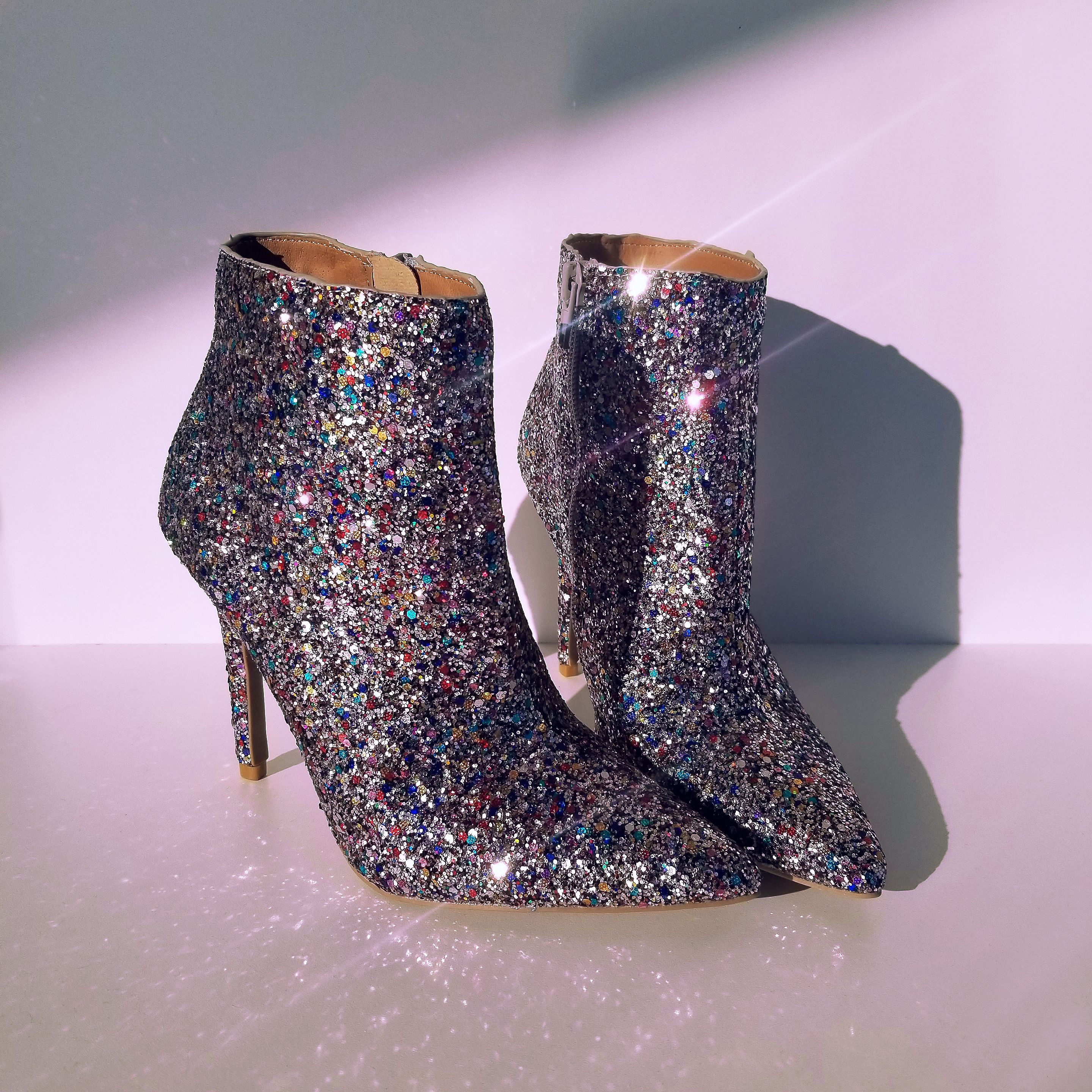 Glitter multi color ankle boots.