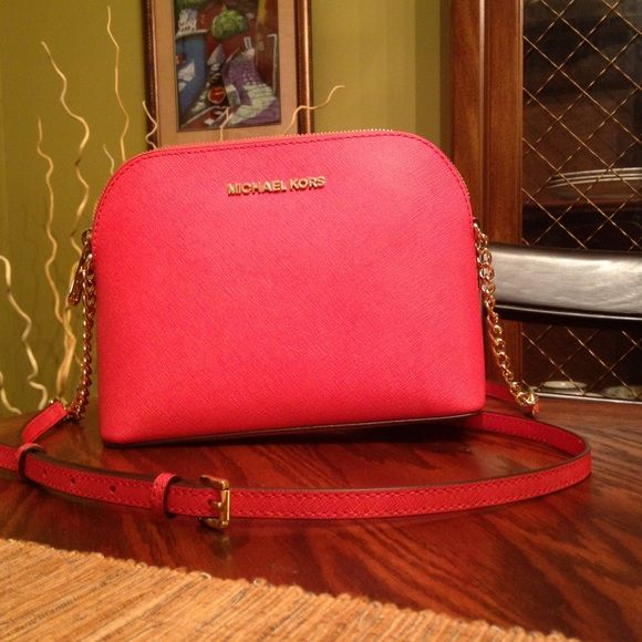 Michael Kors purse Brand new! I wore it only two times! In perfect condition! It is a watermelon color! Looks coral, not pink! Gold colored chains! Dust bag included! Paid full price, 198! Michael Kors Bags Crossbody Bags