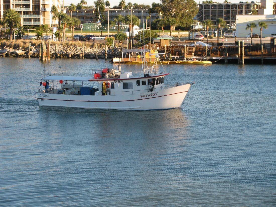 Boat traveling through johns pass madeira beach boat