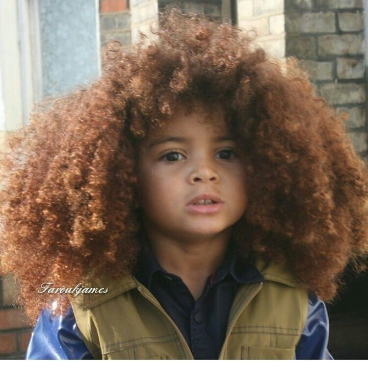 little boy with gorgeous natural curly hair natural hair