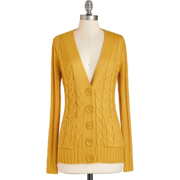 e63509e7a3 Your Fireside of the Story Cardigan in Honey. Snuggled under the cable-knit  front of this golden V-neck