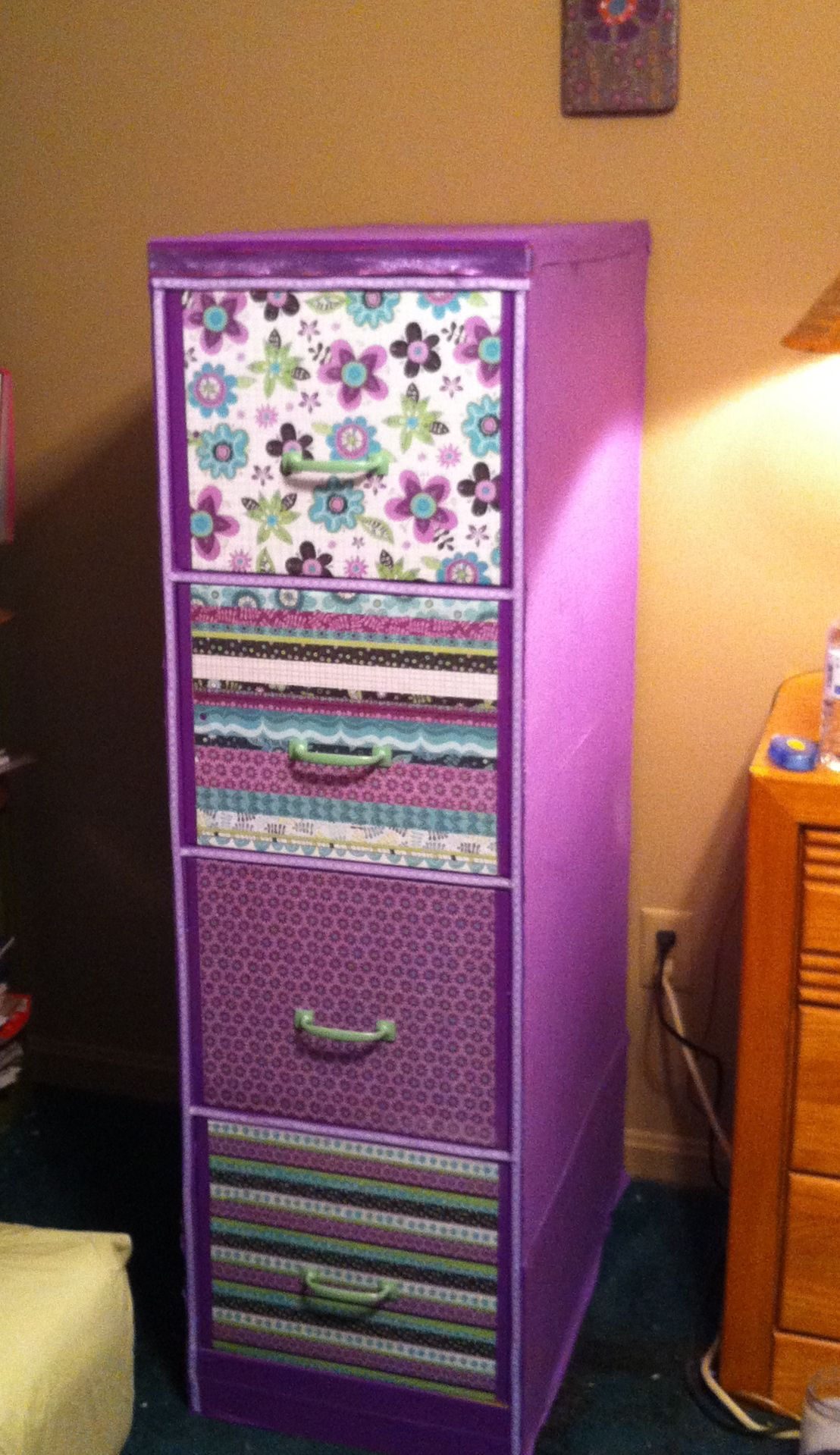 File cabinet makeover with fabric scrapbook paper ribbon