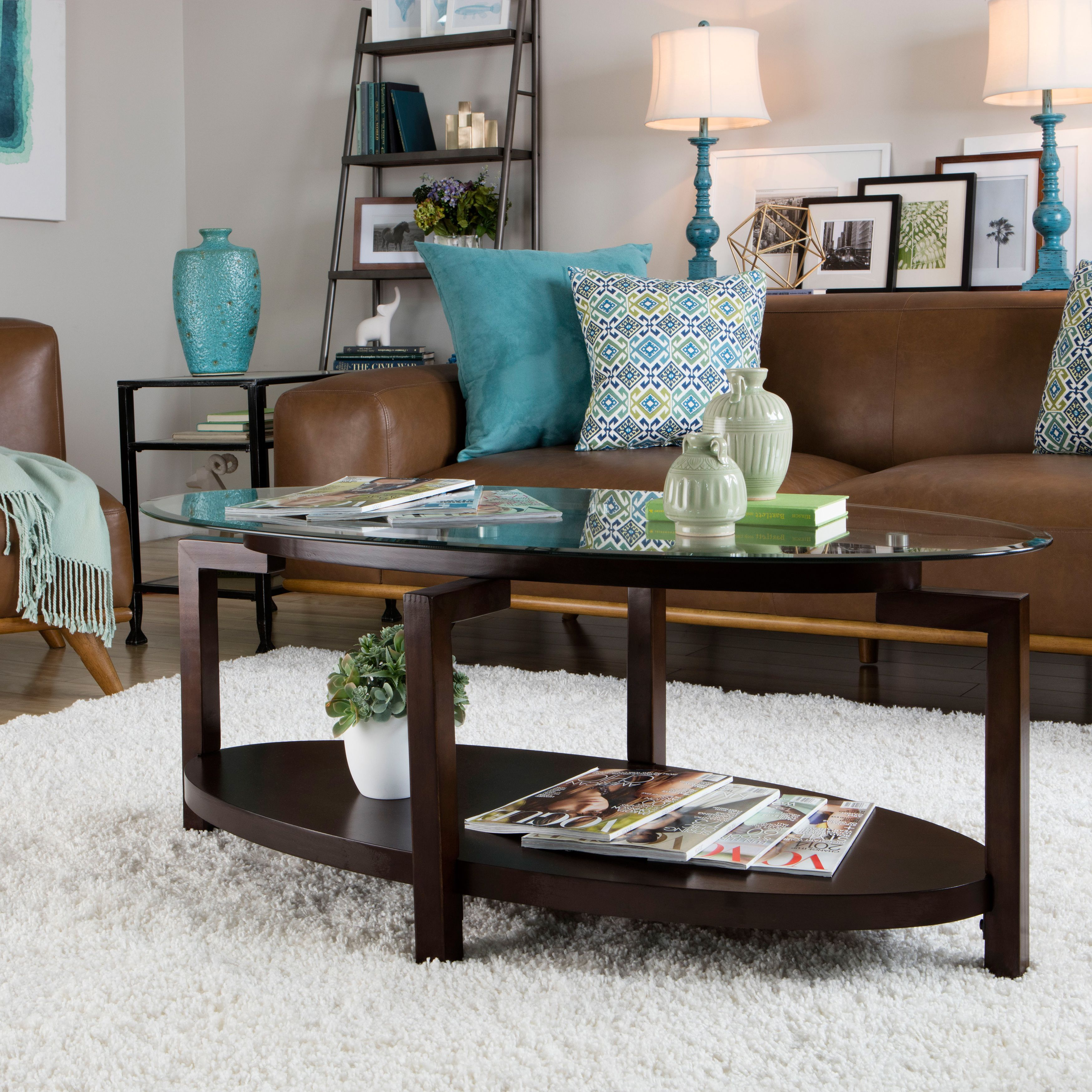 A stylish tempered glass top and rich espresso finish highlight a stylish tempered glass top and rich espresso finish highlight this tanner coffee table this geotapseo Image collections