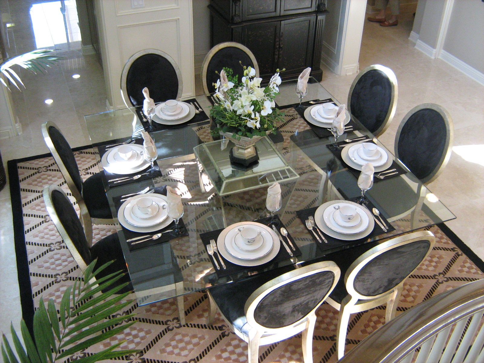 Nice eclectic dining room Square glass table Classic chairs