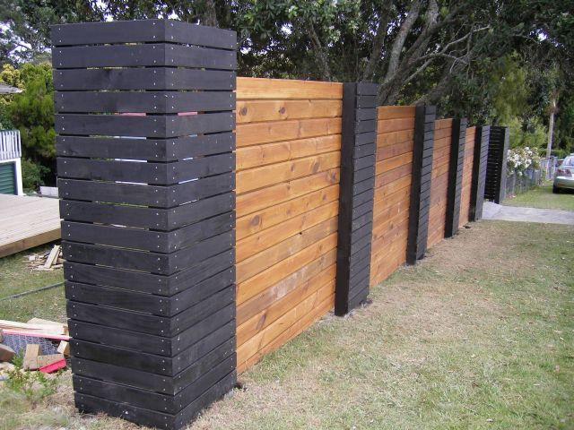 2 colour timber fence with big pillar at its end unusual garden