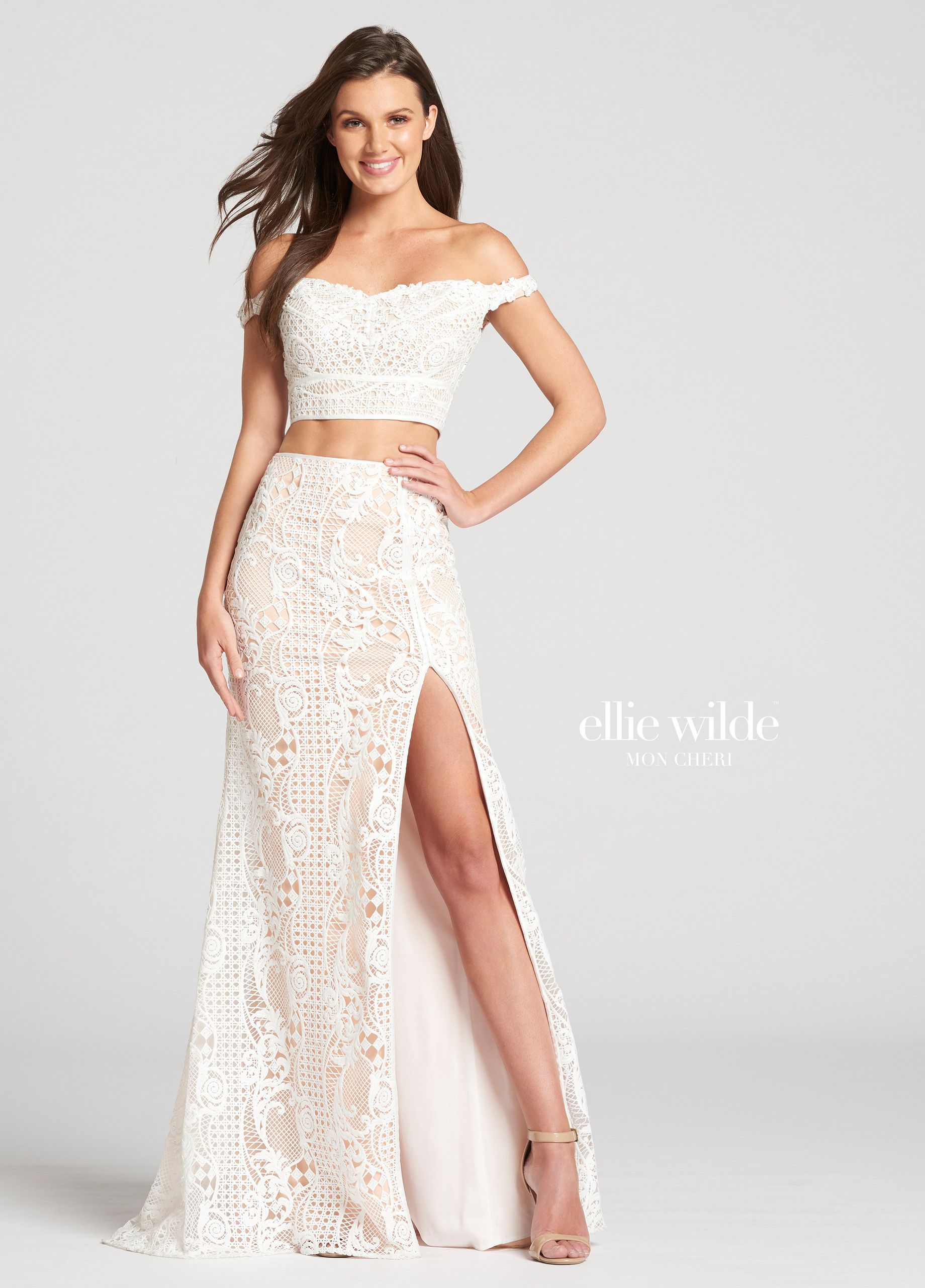 3f7775b3c0fbf1 Nude lining accentuates the lace designs in the cropped top and  high-waisted skirt which is fitted ...