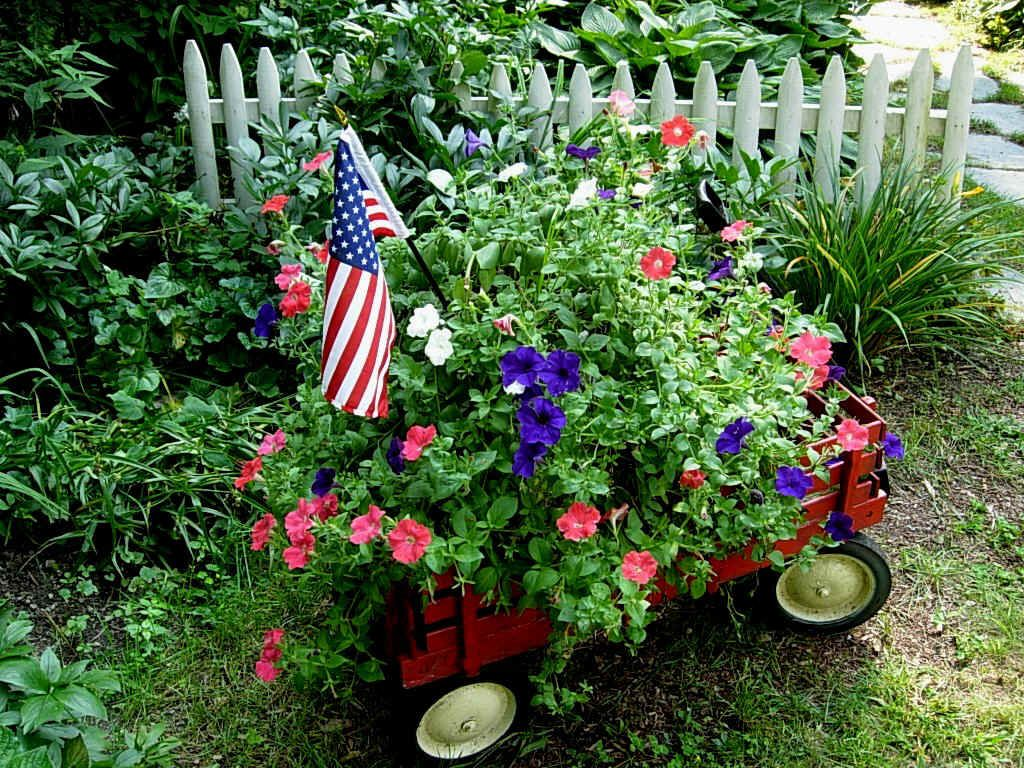 Red wagon filled with summer flowers and a flag.... | Things I love ...