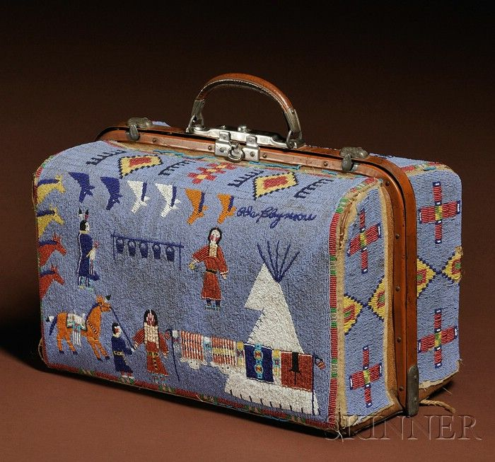 Rare and Historic Plains Pictorial Beaded Suitcase, Lakota, c. late 19th century, the multicolored pictorial beadwork done on buffalo hide and covering a commercial leather and metal period suitcase, using both overlay and lazy stitch, the sides and top with classic 19th century Lakota geometric designs,