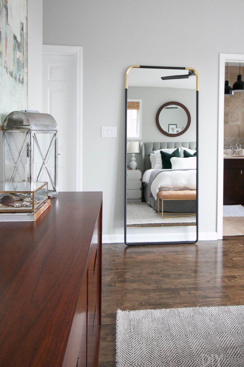 Tips to secure a leaning mirror to a wall in your master bedroom space.