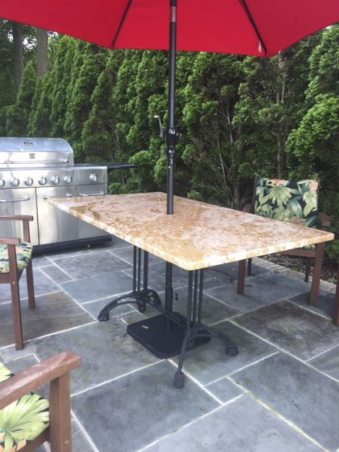 A Custom Granite Patio Table With Our Bruni 2 X 2 Black Cast Iron Table Base
