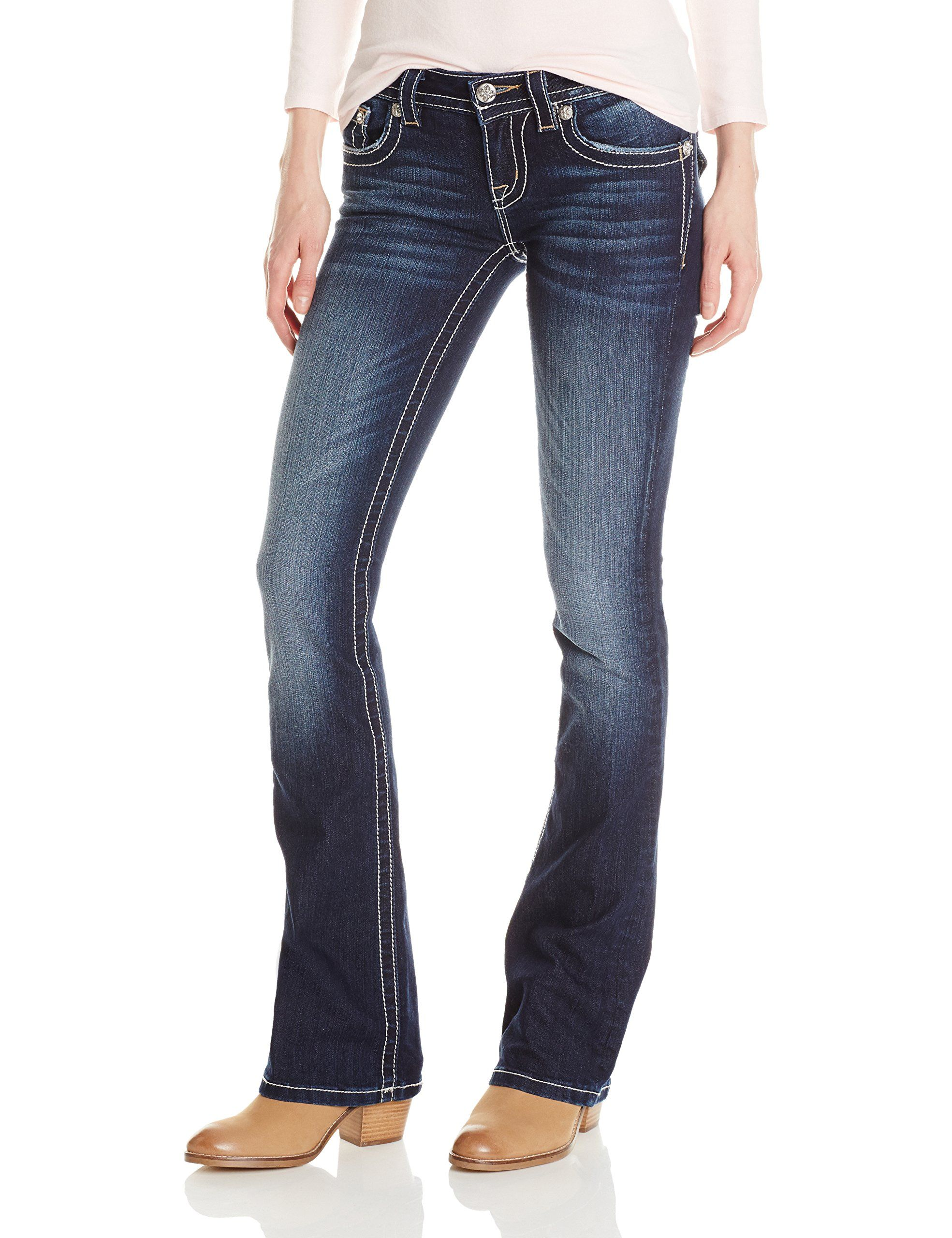 Miss Me Women's Cross Flap Back Pocket Bootcut Jean, Dark Wash, 27. Two tone sequins line flap pocket and create cross design across back pocket. Heavy logo hardware and whiskering throughout jean.