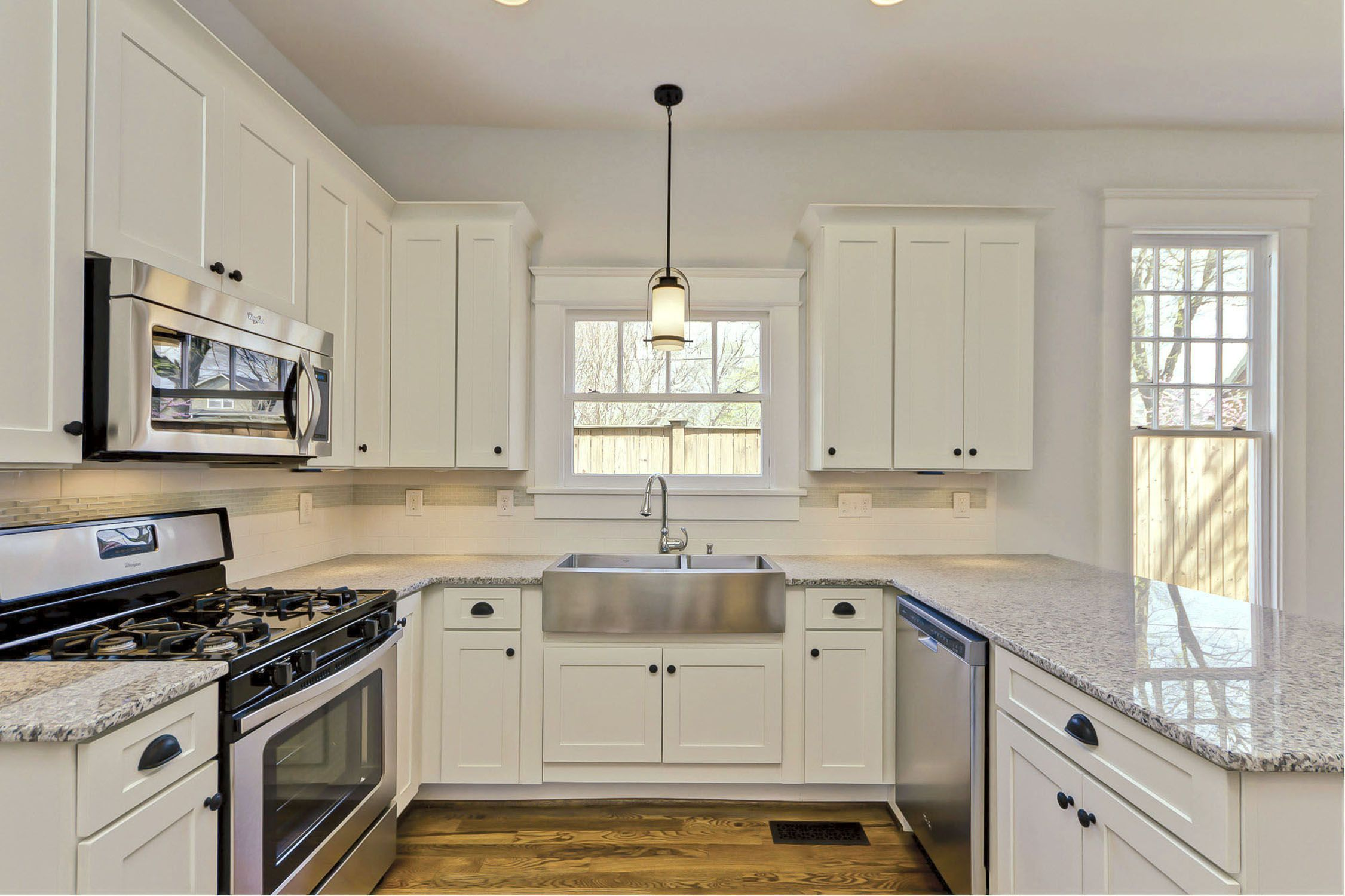 California kitchen has maple cabinets in traditional style with ...