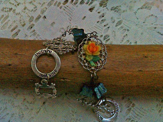 Encourage Spring! Pretty flower and butterfly bracelet. 7 and a half by rowdylady, $10.00. See more in my store:  Etsy.com/shop/rowdylady