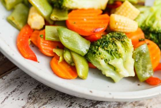 Simple and delicious, roasting vegetables caramelizes their natural sugars. Lightly coat one cubed p... - Shebeko/shutterstock