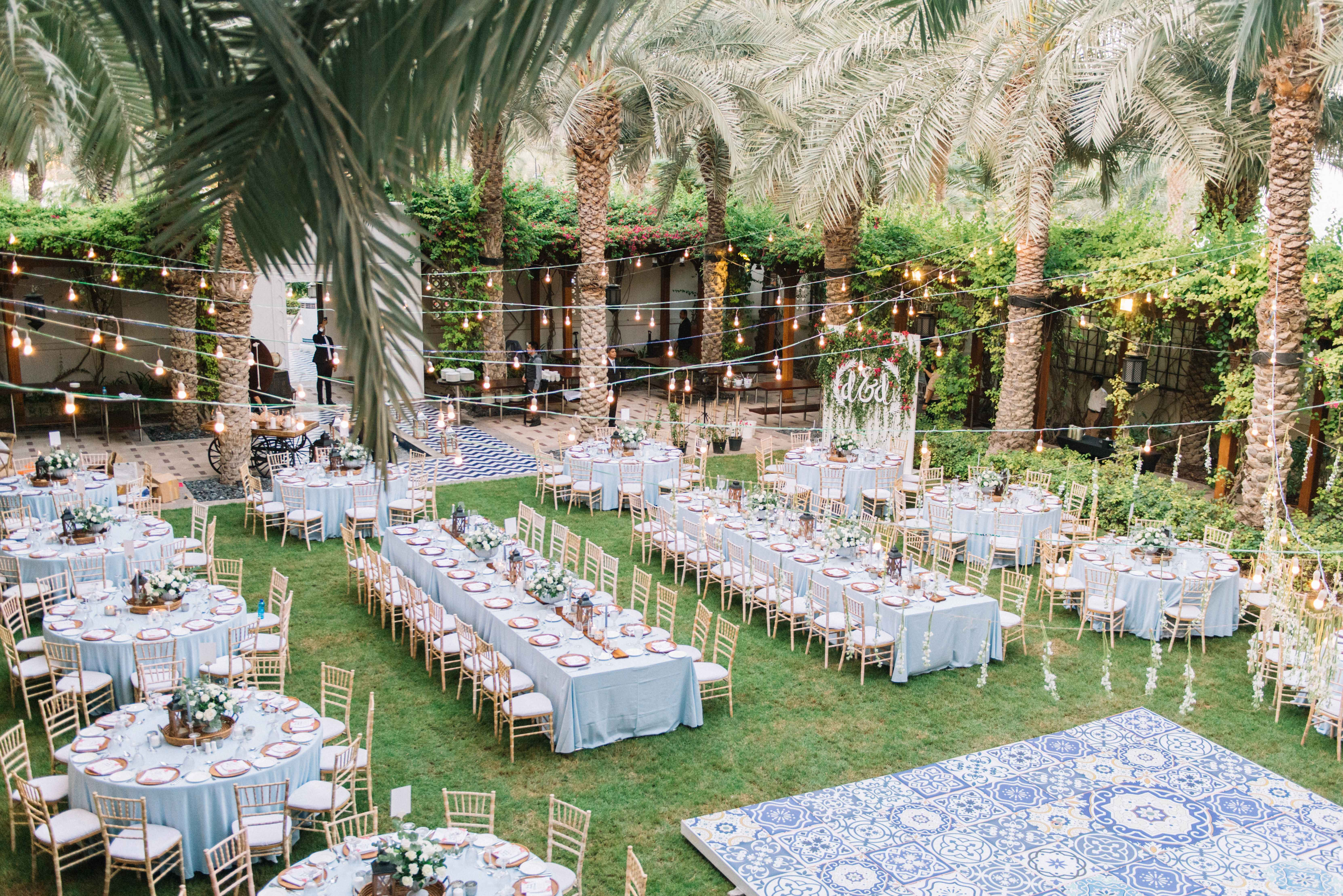 we like these string lights Wedding reception seating