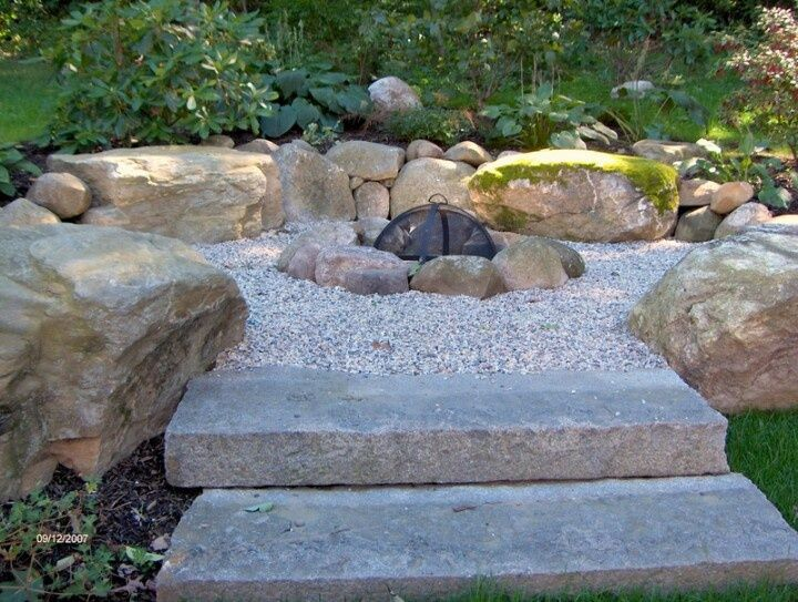 A Backyard Fire Pit Designed With Storage In Mind Speakers Are Hidden The Walls Of Local Stone Outdoor Designs Rocks