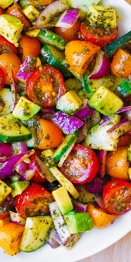 Tomato Cucumber Avocado Salad with Basil Pesto – Healthy, Mediterranean recipe with lots of fresh vegetables.   This recipe uses just a few ingredients, it's easy to make, and the salad looks beautiful on the table for so little effort.  Use both red and yellow cherry tomatoes (or grape tomatoes) to add colors!