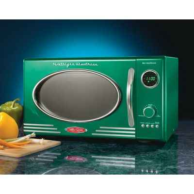 The Nostalgia Electrics Retro Series Microwave Oven Has A Unique And Sleek Design But Brings Fast Cooking Eal Of Modern Liance