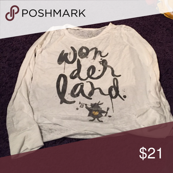 A long sleeved shirt It has an Alice in wonderland reference on it Tops Tees - Long Sleeve