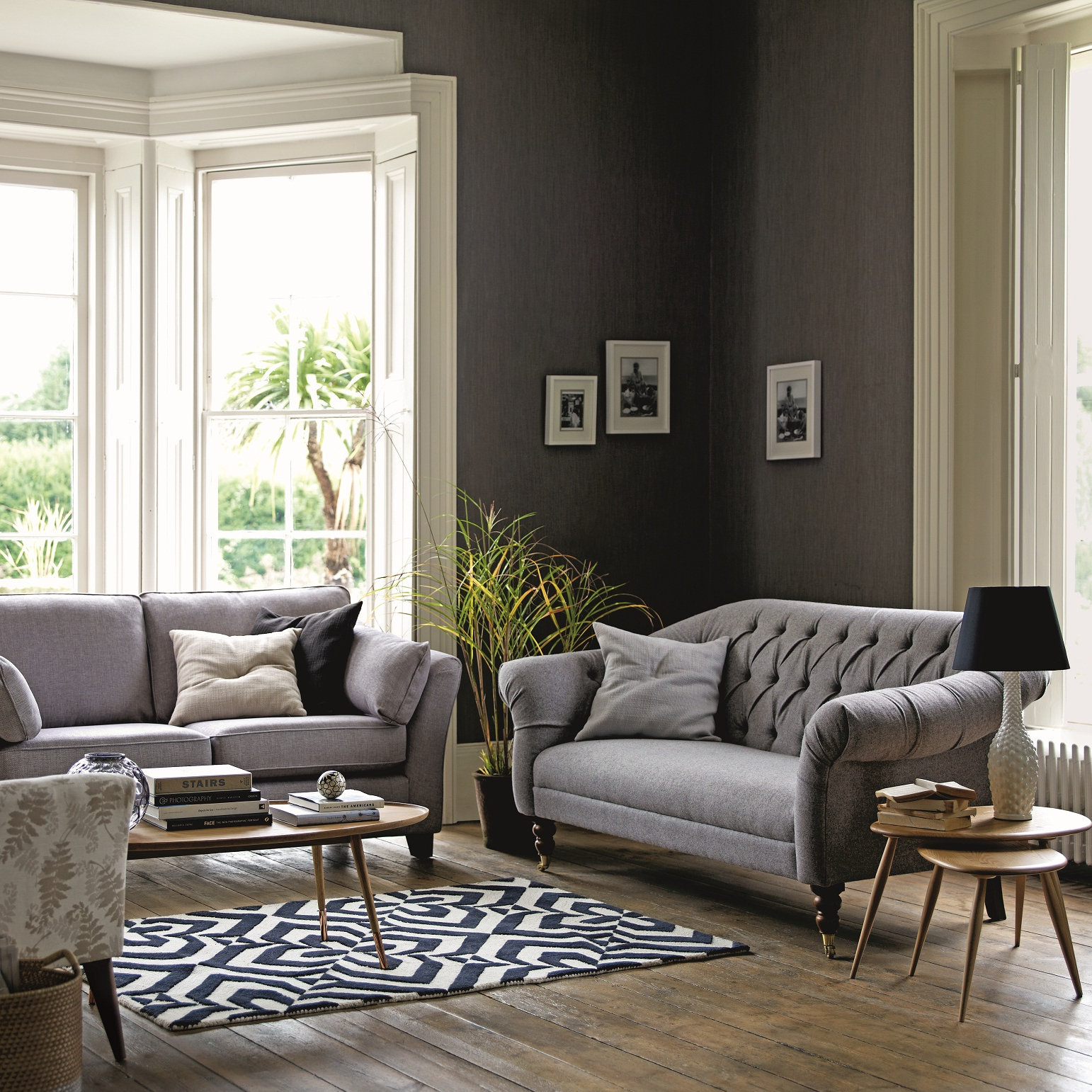 Decorate Your Living Room With Matching Grey Sofas And Liven Up The Interior With A Patterned
