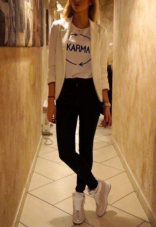 White blazer, black trousers, cream sneakers. Casual style. Women apparel