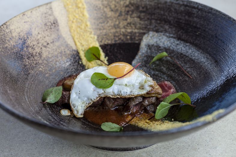 Picanha Tataki, foie gras, aji panca, fried quail egg from Cláudio Cardoso, SUSHISAMBA