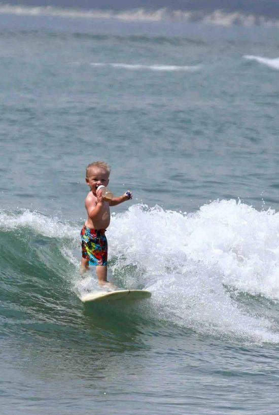 Cute baby surfing like a pro while drinking from a bottle 주식사이트 주식사이트 주식사이트…